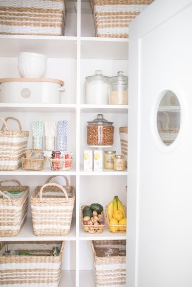 How to Organize a Pantry in pantry with woven baskets