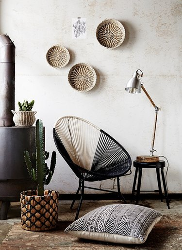 white and black Acapulco chair in modern southwestern room