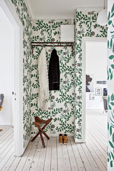 Hallway with botanical green wallpaper
