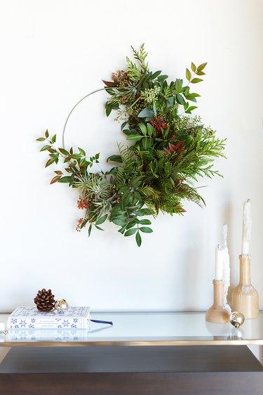 wreath made of eucalyptus, cedar, grevillea foliage, and nandina
