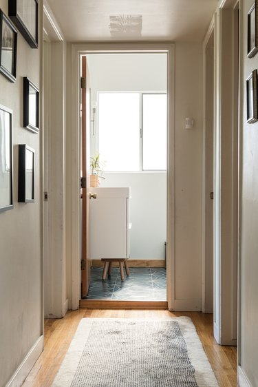 Taupe color in hallway with gallery wall
