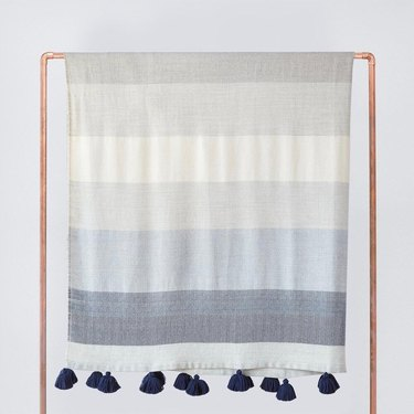 Blue and gray blanket with navy tassels