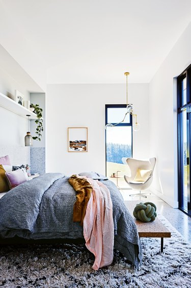 Bedroom with curved Arne Jacobsen Egg Chair