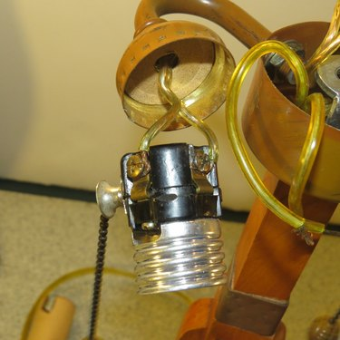 Detached light bulb socket with wires attached.