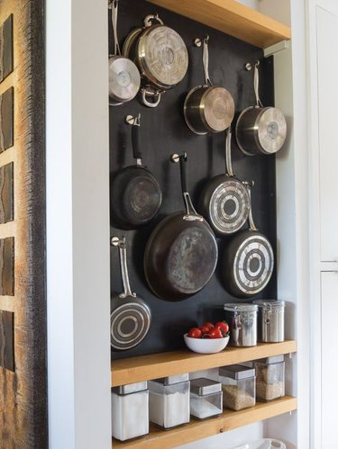How to Organize a Pantry with pots and pans hanging on wall