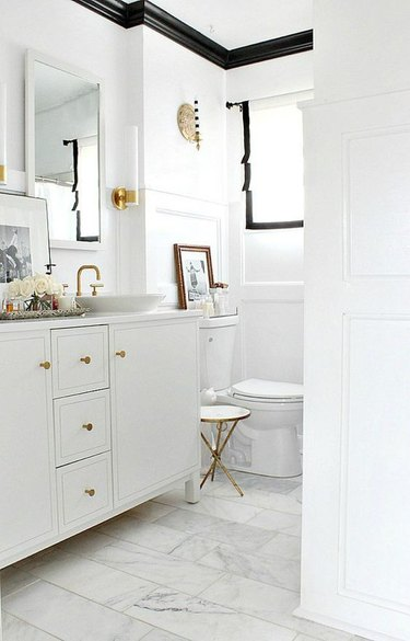 white small bathroom with black trim moldings