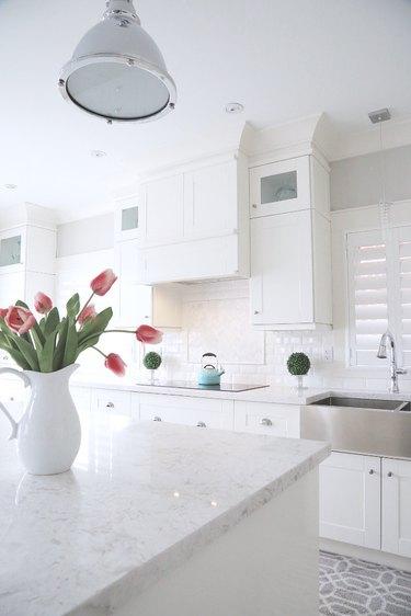 white quartz marble-look countertops in white kitchen