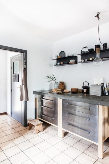 farmhouse kitchen with concrete countertop and stainless steel drawer fronts