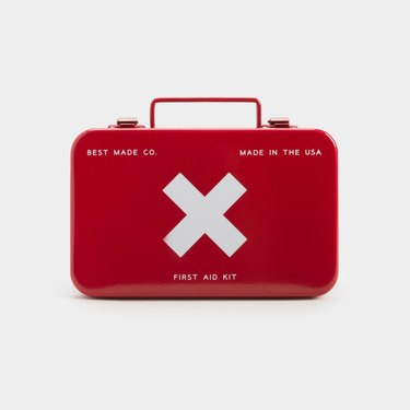 A red metal first aid kit with a white X on the front.