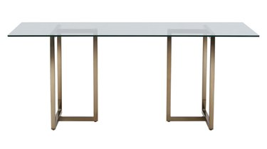 Rectangular glass dining table with brass legs