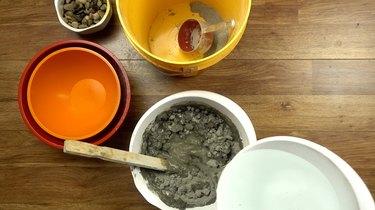 Mixing concrete for DIY tabletop concrete fire bowl.