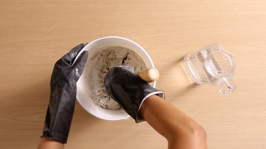 Mixing Portland cement, sand, and water