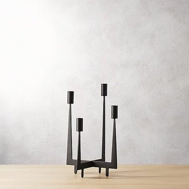 Minimal black candleholder with four arms for candles
