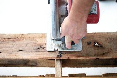 Circular saw cutting pallet wood.