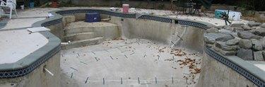 Empty concrete pool under repair