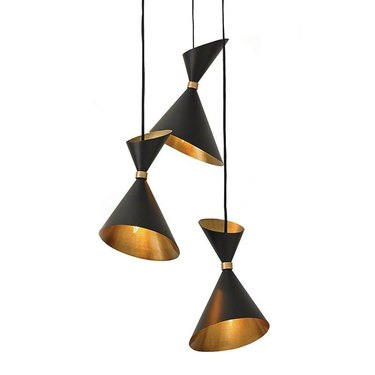 Trio of cone-shaped black pendants with gold interior