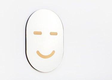 2Modern face mirror.