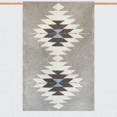 Gray area rug featuring global patterns