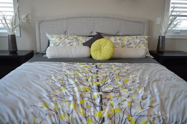 Bed made with colorful duvet and pillows
