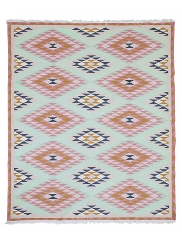 Area rug with blush and baby blue global pattern