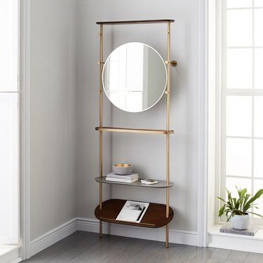 A West Elm entryway mirror with shelving unit.