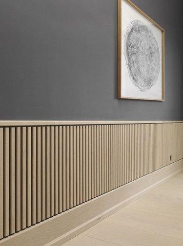 light finish wood board and batten wainscoting minimalist Scandinavian room