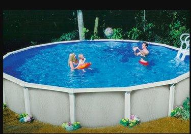 Family enjoying an above-ground swimming pool.