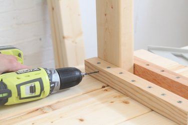 Drilling a pilot hole into the leg