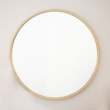 Large round mirror with gold frame