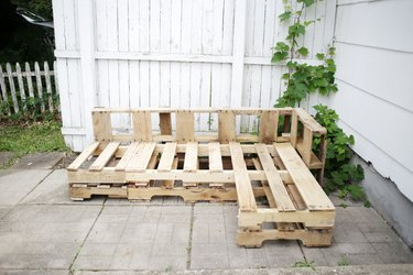 L-shaped wood pallet couch.