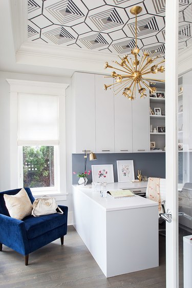 White and blue office with white and blue graphic ceiling