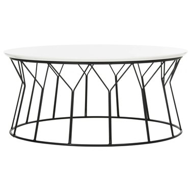Round white lacquer coffee table with black wire base