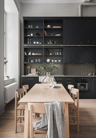 black kitchen with metallic hardware