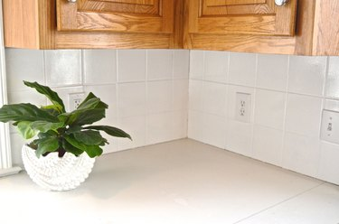 corner of kitchen with painted white tile