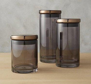 grey jars bathroom countertop