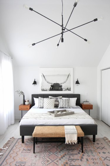 Farmhouse Chic Bedroom Ideas in Bedroom with rustic bench, modern chandelier, large photo