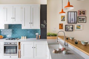 L-shaped kitchen with white cabinets and tile backsplash
