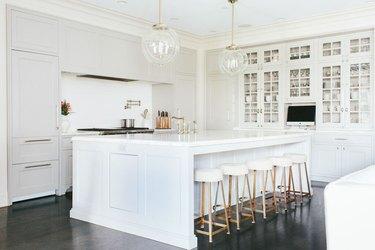 all-white L-shaped kitchen