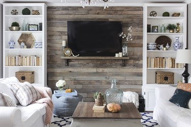 Wood pallet accent wall between two bookshelves