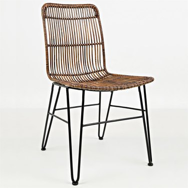 Woven dining chair with black metal legs