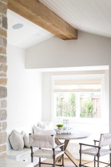 farmhouse kitchen with a breakfast nook by window