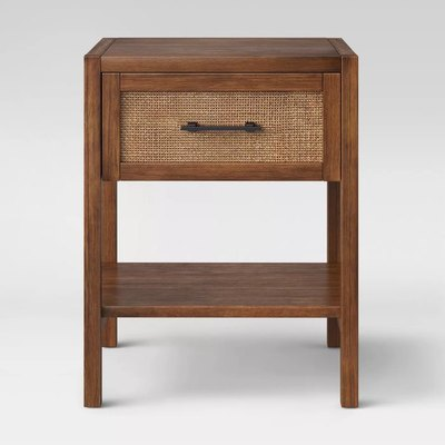 Featuring a durable wood frame, this wood-finish accent table strikes a clean-lined silhouette and is easy to complement a wide range of design aesthetics and color palettes. The rectangular tabletop and lower shelf are perfect for decor, framed photographs and other items, while the rattan mesh-panel drawer enhances the visual appeal and provides you space to stash TV remotes, coasters and other daily essentials.
