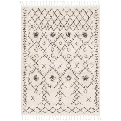 This beautiful modern bohemian area rug perfectly intertwines traditional tribal patterns with modern sensibilities and design to create a splendid piece that would make a wonderful addition to any decor space.