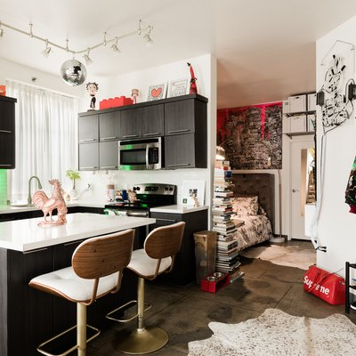 kitchen with red accents, white countertop, dark wood cabinetry