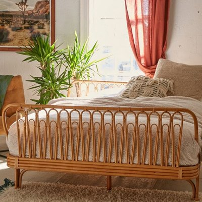 bohemian bedroom with rattan bed
