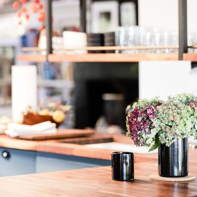 focus on flowers on a wood countertop