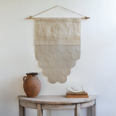 Scalloped leather and burlap wall hanging