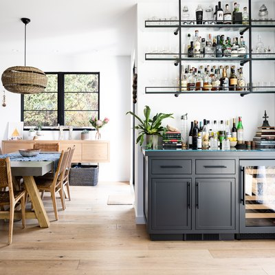 dining area with bar and blonde wood flooring