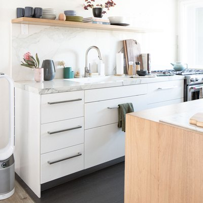 small Hunker House kitchen with faucet, sink, and gas stove and oven