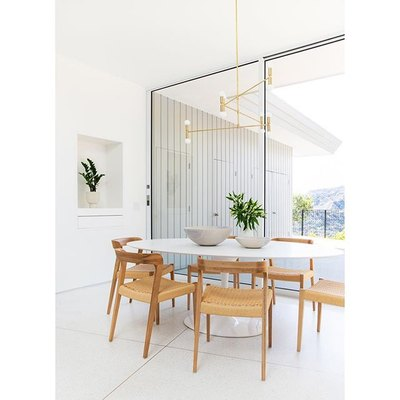 A Statement Light Elevates a Minimal, Breezy Dining Room